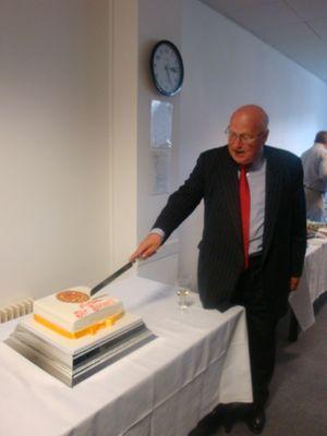 sir-stuart-etherington-cuts-his-cake1.jpg